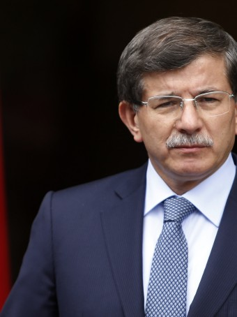 "Turkey's Foreign Minister Ahmet Davutoglu addresses the media in Ankara in this June 13, 2013 file photo. Davutoglu said Syria's worsening war now posed a danger to all countries because President Bashar al-Assad's government had been allowed to continue its ""crimes"" while jihadists from around the world flooded in to fight him. To match Interview SYRIA-CRISIS/TURKEY   REUTERS/Umit Bektas/Files (TURKEY - Tags: POLITICS PROFILE)"